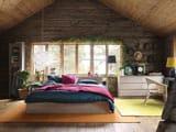 Советы по обустройству интерьера мансардной спальни