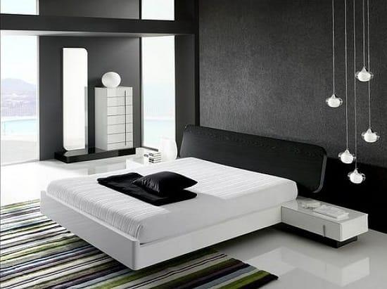 Черная отделка стен в сочетании с белым полом и мебелью в спальне