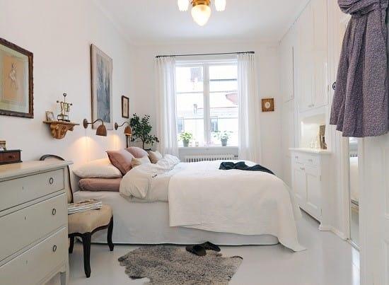 Мебель белого цвета в спальне скандинавского стиля