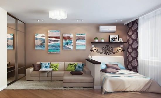 Зонирование спальни гостиной при помощи невысокой кирпичной перегородки