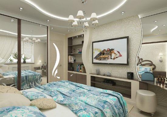 Эргономиный дизайн со встроенной в ниши мебелью в спальне гостиной