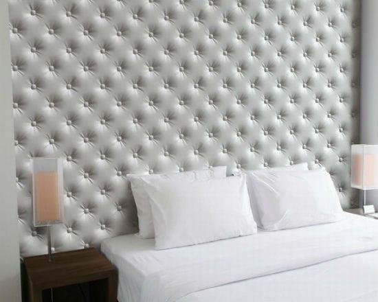 Красивая стеновая панель с имитацией каретной утяжки в спальне