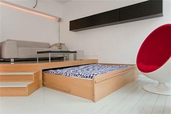 Идея для дизайна спальни гостиной с выкатной кроватью и подиумом