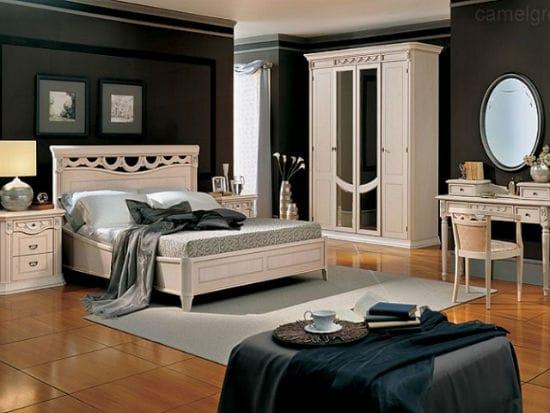 Красивый контраст между белой мебелью и черными стенами в спальне