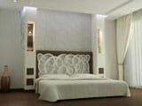 Оформление изголовья кровати спальни красивой резной панелью